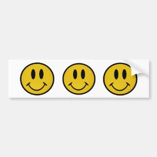 Cara sonriente de oro etiqueta de parachoque