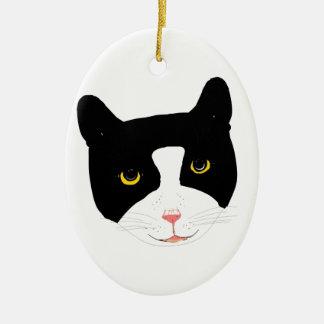 Cara sonriente del gato adorno navideño ovalado de cerámica