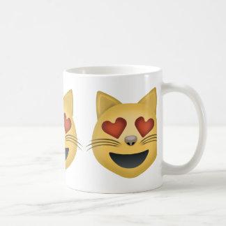 Cara sonriente del gato con los ojos en forma de taza básica blanca