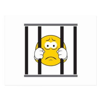 Cara sonriente en cárcel postales
