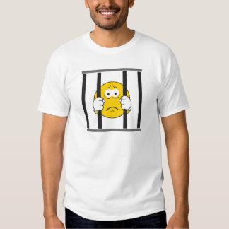 Cara sonriente en cárcel remeras