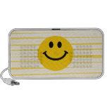 Cara sonriente en rayas amarillas soleadas notebook altavoces