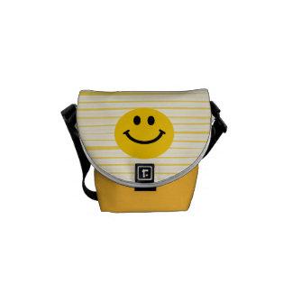 Cara sonriente en rayas amarillas soleadas bolsas messenger