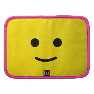 Cara sonriente feliz amarilla organizadores