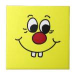 Cara sonriente Grumpey del genio Teja Cerámica