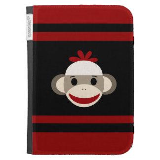 Cara sonriente linda del mono del calcetín en negr