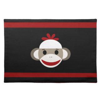 Cara sonriente linda del mono del calcetín en negr mantel individual