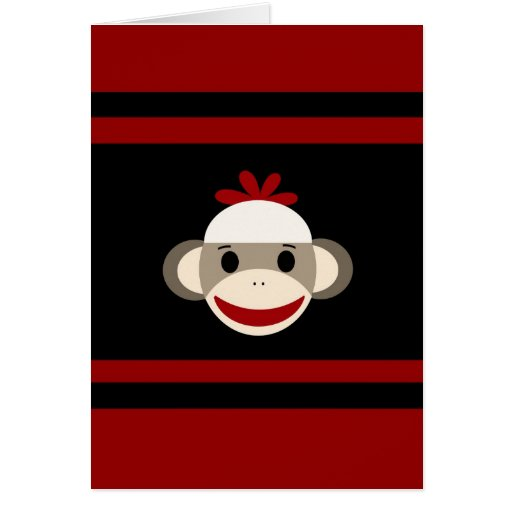 Cara sonriente linda del mono del calcetín en negr felicitaciones