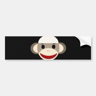 Cara sonriente linda del mono del calcetín en pegatina para auto