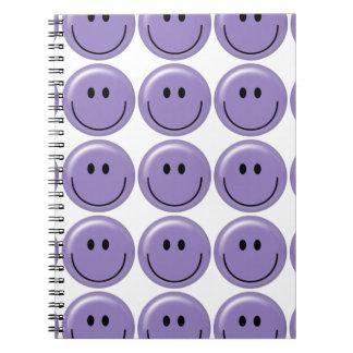 Cara sonriente púrpura feliz libro de apuntes