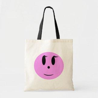 Cara sonriente rosada bolsas de mano