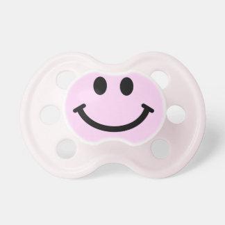 Cara sonriente rosada chupetes para bebés
