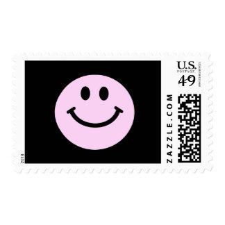 Cara sonriente rosada franqueo