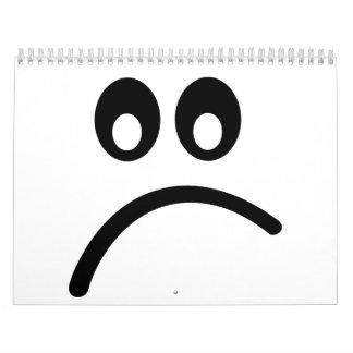Cara sonriente triste calendarios de pared