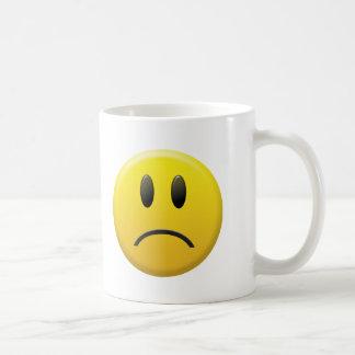 Cara sonriente triste tazas de café