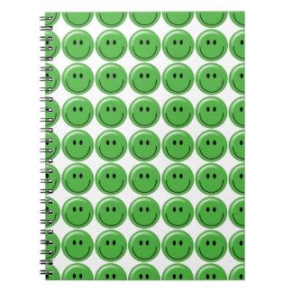 Cara sonriente verde feliz libreta