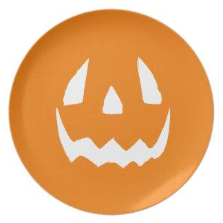 Cara tallada de la calabaza de Halloween Platos De Comidas