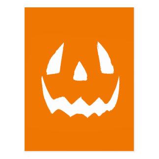 Cara tallada de la calabaza de Halloween Postales