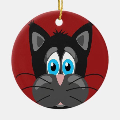 Cara triste del gato en un fondo rojo ornamento para reyes magos