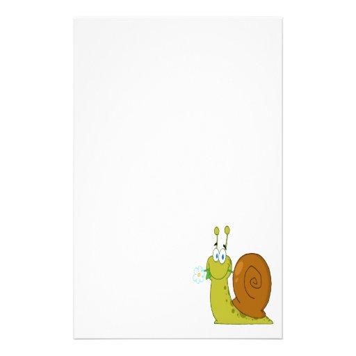 caracol feliz del dibujo animado con la flor papelería