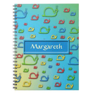 Caracoles coloridos por todas partes note book