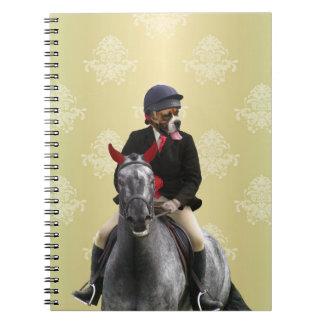 Carácter divertido del jinete del caballo note book