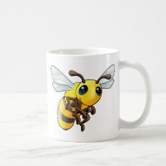 Carácter lindo de la abeja taza