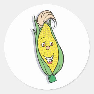 carácter sonriente del maíz pegatina redonda