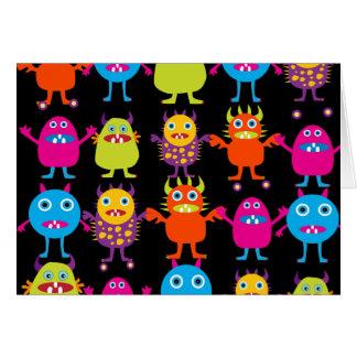 Caracteres coloridos divertidos de las criaturas d felicitaciones