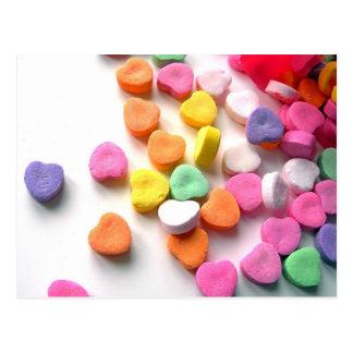 Caramelo de los amores de las tarjetas del día de  tarjeta postal
