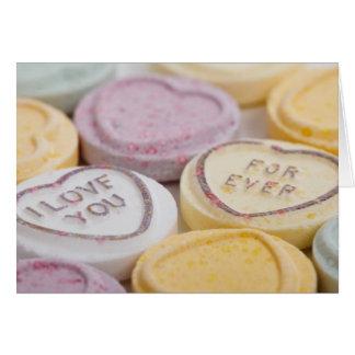 Caramelo del corazón de la tarjeta del el día de S