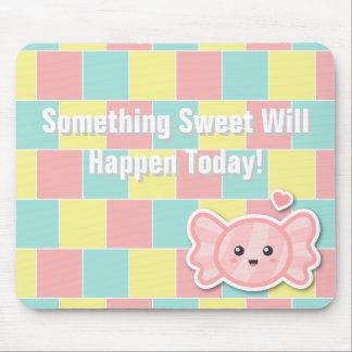 Caramelo dulce en fondo en colores pastel colorido alfombrilla de ratones