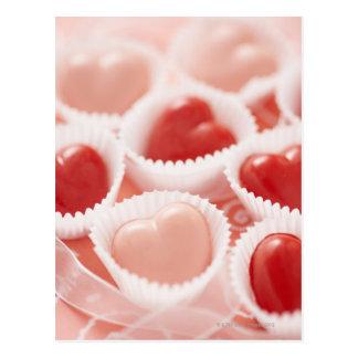 Caramelos en forma de corazón postal