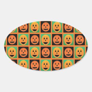 Caras de la calabaza del feliz Halloween Pegatina Ovalada