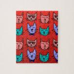 Caras del gato en rojo rompecabezas