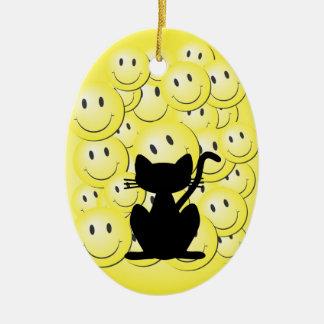 Caras e ilustraciones felices del gato adorno navideño ovalado de cerámica