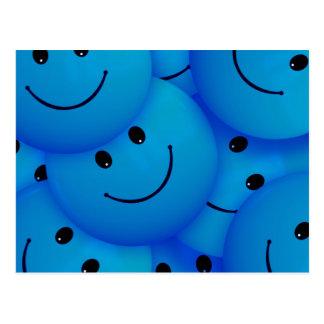 Caras sonrientes azules felices frescas de la postal