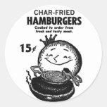 Carbón de leña-Fried' de las hamburguesas del Etiqueta Redonda