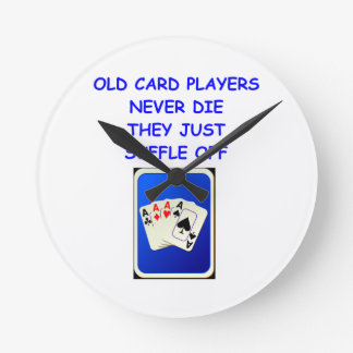 card players round wall clock