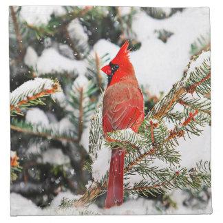 Cardenal en un árbol de pino servilletas imprimidas