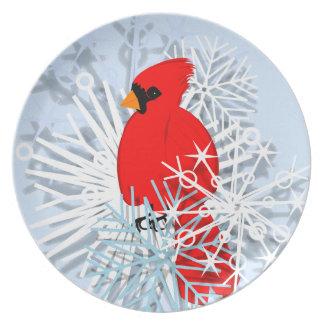 Cardenal rojo en estrellas de la nieve plato