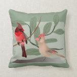 Cardenales dos pájaros rojos en rama cojines