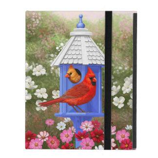 Cardenales y Birdhouse azul