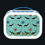 """Cardigan Welsh Corgi Lunch Box<br><div class=""""desc"""">Cute cartoon style black and white Cardigan Welsh Corgi with a scattering of bones and paw tracks. This design is intended to tile seamlessly.</div>"""