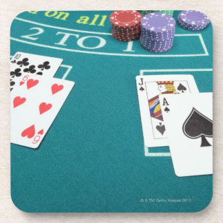 Cards and chips on betting table coaster