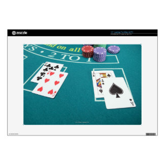 Cards and chips on betting table laptop skins