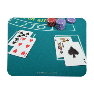 Cards and chips on betting table magnet