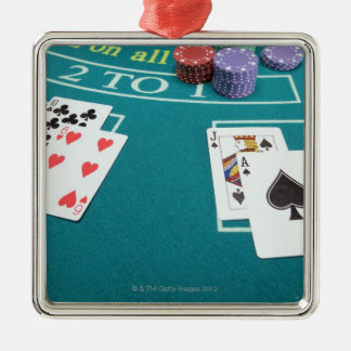Cards and chips on betting table metal ornament