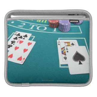Cards and chips on betting table sleeve for iPads