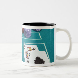 Cards and chips on betting table Two-Tone coffee mug
